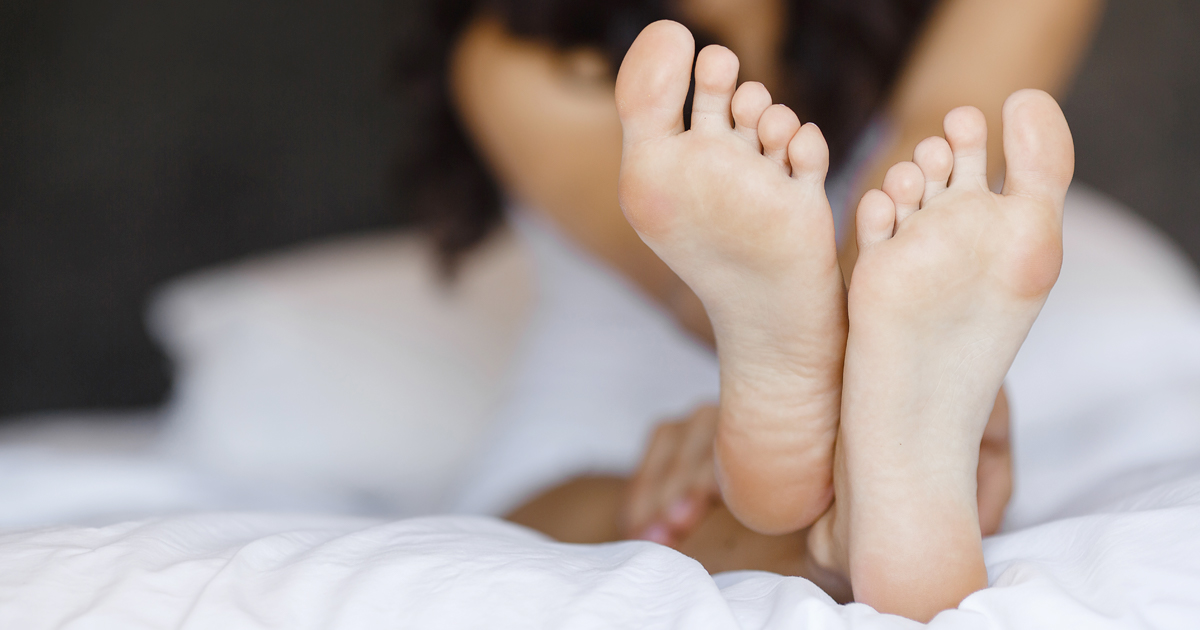 closeup of feet on bed